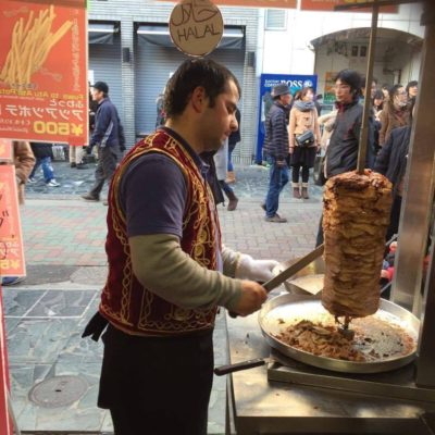 man cutting kebab