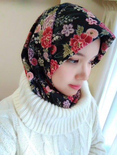 Put the low part of hijab to the turtle neck or simply tie both tips behind the neck. It will warm you up!